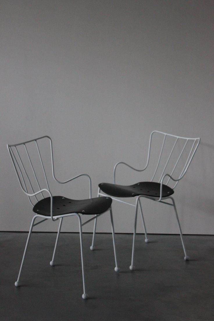 A pair oforiginal Antelope chairs,by Ernest Race – originally designed for The Festival of Britain. The chair was also awarded the Silver Medal at the Triennial in Milan in 1954.  Cold bent steel rod, moulded plywood seat, and brass feet. – This set have been sympathetically restored – resprayed in white, and seat painted...