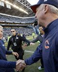 Seattle Seahawks head coach Pete Carroll, left, and Chicago Bears head coach John Fox, right, shake hands following an NFL football game, Sunday, Sept. 27, 2015, in Seattle. The Seahawks beat the Bears 26-0. (AP Photo/Elaine Thompson)