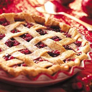 Home-Style Cran-Raspberry Pie Recipe -With ruby-red fruit and a golden lattice crust, this home-style pie is absolutely perfect for your Christmas table. The sweet-tart berries are accented with a hint of almond. —Vivian Gallagher, Berlin, New Jersey