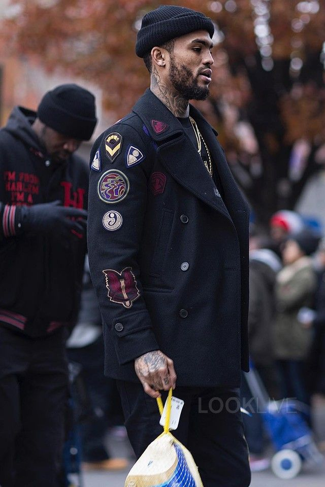 Dave East wearing  Dries Van Noten Patch Wool Coat