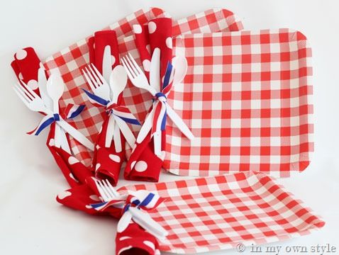 Punch hole in paper plate and tie ribbon around napkin & utensils.  It's much easier for your guests to grab one thing instead of five!