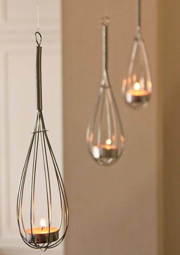 Whisk Lights~ Isn't this super cute???? .. Just hang your whisks from the little loops and slide a tea light candle inside.
