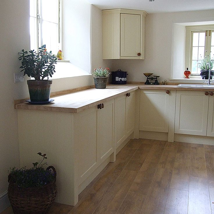 Shaker kitchen doors shown integrated within two full height, 95mm wide pillasters. These can be made in different widths as necessary as available space allows. Shown here finished in Dulux Heritage Cream. See more here http://colinspicer.co.uk/painted-shaker-kitchens-wales