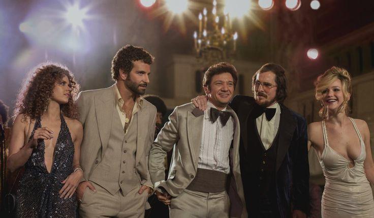 Amy Adams, Bradley Cooper, Jeremy Renner, Christian Bale, and Jennifer Lawrence in American Hustle.