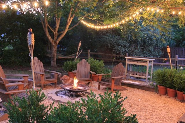 backyard firepit surrounded by gravel.  I love the lights too.