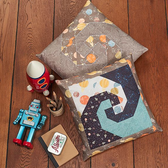 "FREE PATTERN DOWNLOAD: Make this quirky Lewis & Irene To the Moon and Back Cosmic Cushion. Finished size 18"" x 18""."