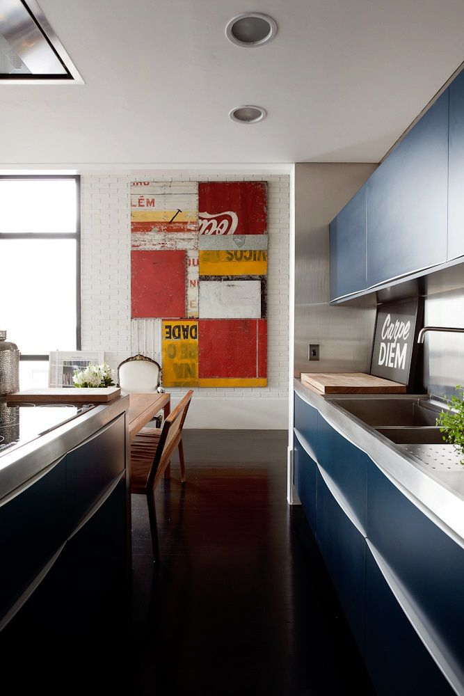 Usually sleek contemporary is not my style, but I like the coca cola collage, wood dining table and the Cape diem sigb in contrast to cold sterile kitchen cabinets