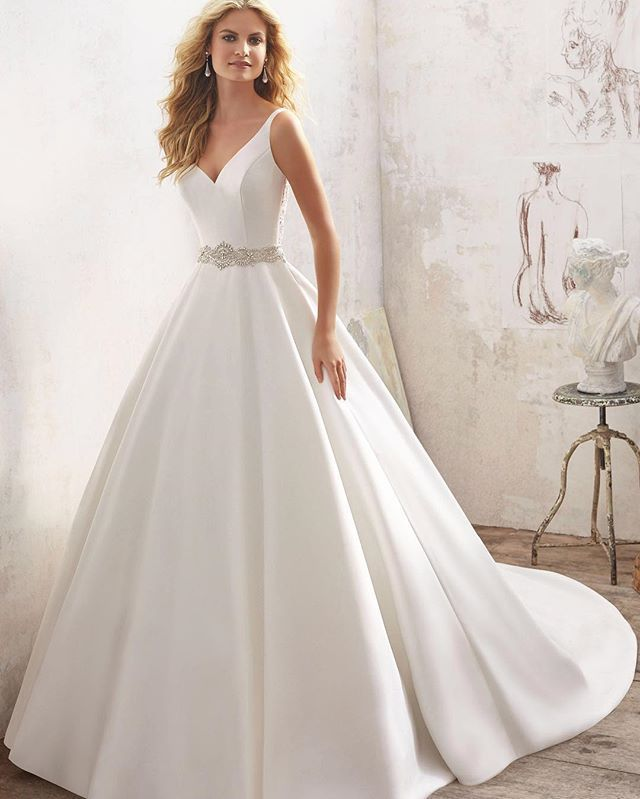 Embroidered Edging with Crystal Beading Meets the Alencon Lace Appliques and Scalloped Hemline on the Net Wedding Dress. Colors:White/Silver, Ivory/Silver and more