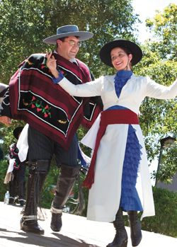 Dressed in colorful traditional Chilean costumes, members of the Araucaria dance ensemble perform traditional dances.