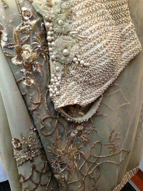 It all beadwork and brocade for the out fit.  Love the winter woods on lower part.. (-Pearl and floral detailing on the blouse)