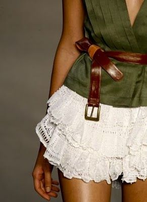 Love the white lace tiered skirt paired with army green shirt and that color belt but not too crazy about that belt or how it's tied