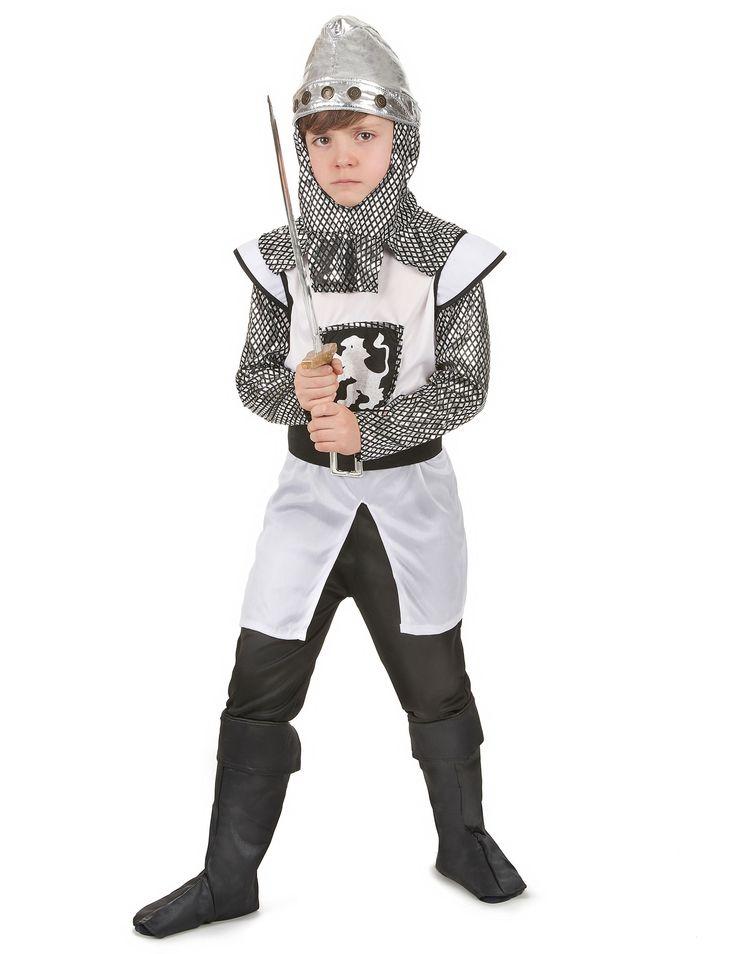 Disfraz de caballero cruzado medieval para niño: Disfraz de cruzado para niño compuesto por una túnica, un gorro, un cinturón negro con hebilla plateada y unos cubrebotas.La túnica blanca con emblema bordado en el torso...
