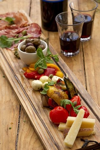 Cafe Paradiso have a vegetable or meat antipasti that can be made to serve one or even four people. There is a choice between vegetable antipasti filled with grilled artichokes,peppadews,pepper relish etc... or meat antipasti filled with proscuitto, coppa, salami,nostrano,pecorino.. etc