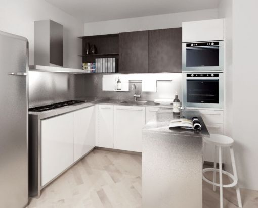 cucina moderna ad angolo con tavolo scorrevole a scomparsa in acciaio inox