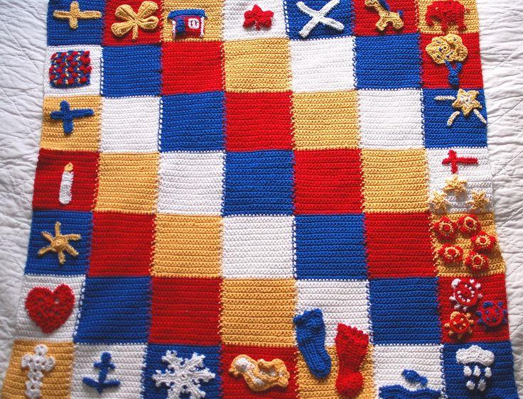 Svensk-kanadensisk bäbisfilt, i de två flaggornas färger. Swedish-canadian baby-blanket, in the colours of the two flags..
