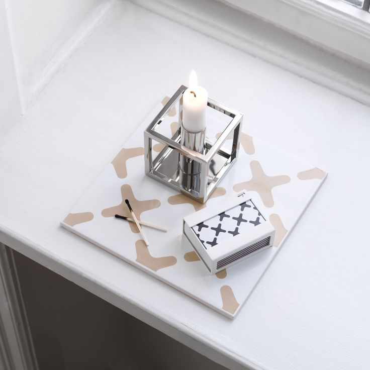 A new member of the by Lassen Kubus family - a nickel-plated version of the Kubus 1 candleholder. Simple and classi.