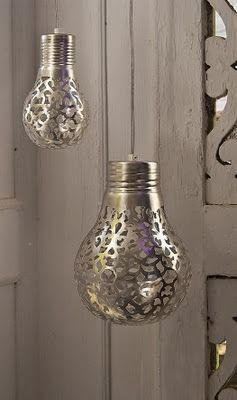 Cover a light bulb with a doily and spray paint it. The light will shine the…