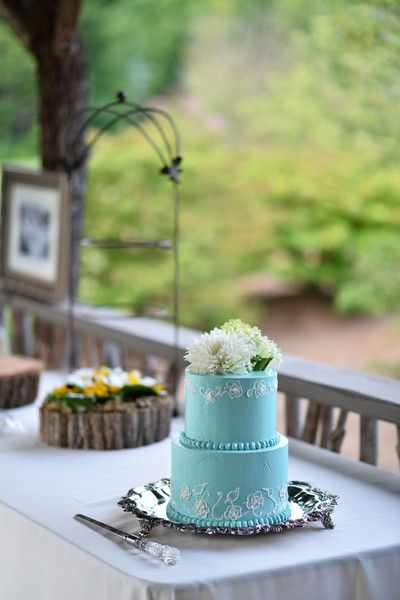 Petite two-tier wedding cake with blue icing and white piped design - topped with fresh flowers! {Thirteenth Moon Photography LLC}