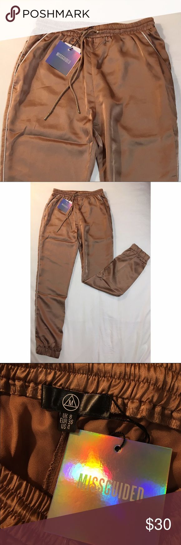 Misguided Satin Cuffed Joggers Very soft satin joggers with a white stripe down the side of the pants. These ROSE GOLD pants can be dressed down with sneakers or dressed up with heels. Misguided US Pants Track Pants & Joggers