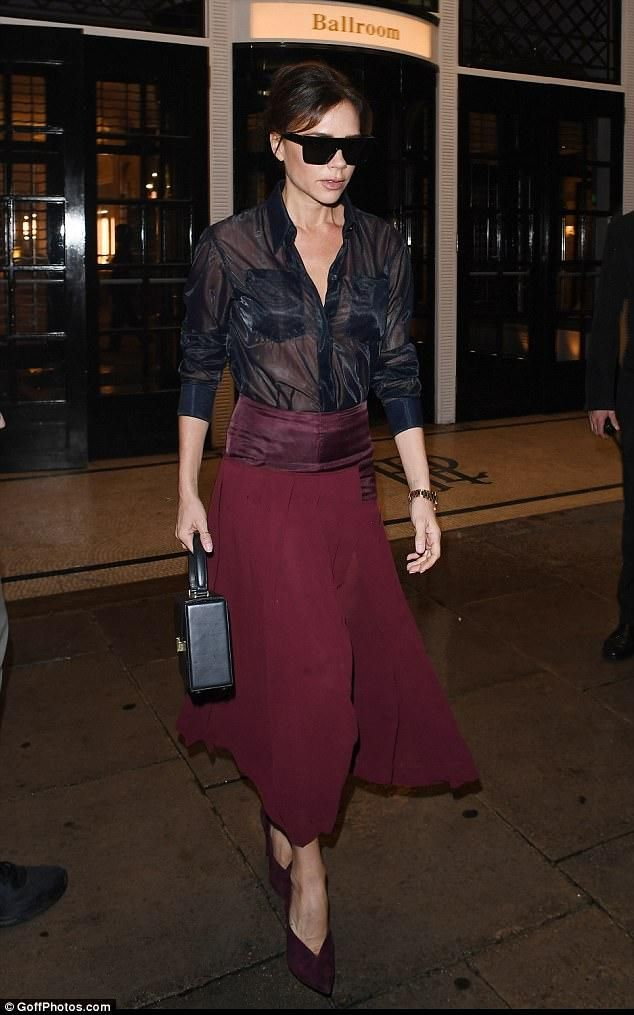 Victoria Beckham wearing Victoria Beckham Vanity Top Handle Bag in Black, Victoria Beckham Patch Pocket Shirt, Victoria Beckham Pleated Sheer Skirt and Victoria Beckham Pin Pumps