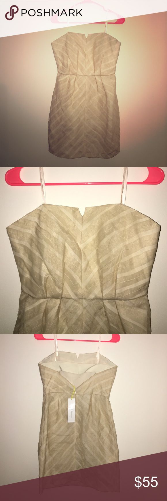 NWT BCBGeneration Beige Cocktail Dress Size 6 New with tags beige BCBGeneration strapless lined cocktail dress size 6. Back has a cute cutout and back zip closure. BCBGeneration Dresses Strapless