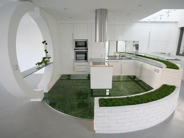 Formes arrondies d'une cuisine en blanc et vert