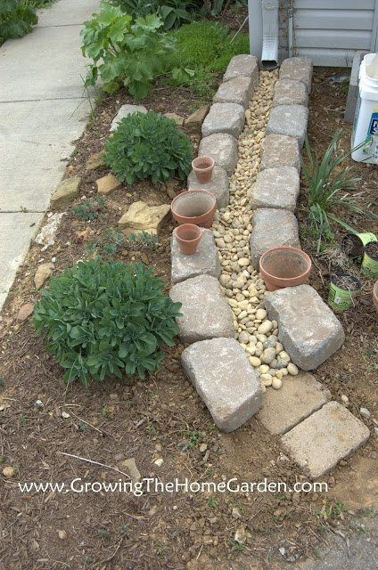 Cute idea for drainage!  Use flat pavers along driveway edge, a water pathway of stone with black cloth underneath, rough organic looking pavers like these along grass edge.  Keep the the pavers level with the ground so the lawn mower blades will not hit.  This also means digging the water pathway lower than the paver path.
