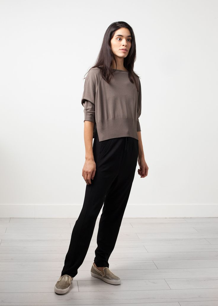 This is a demonstration store. You can purchase products like this from Baby & Company True versatility of pieces, the collection is diverse yet harmonizing with each other. The Alia Knit Trouser by Annette Gortz is essentially a classy sweat pant. Draw string waist band. Side angled pockets at front. Tapered leg with a subtle racing stripe. Color Black. 96% Viscose, 4% Polyester. Made in Germany. Ashley is wearing an X Small.
