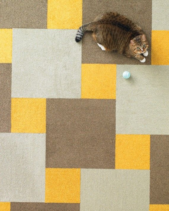 Similar to the designs often found on ceramic tile floors, this pattern is made of full-size carpet tiles surrounded by quarter-tile pieces. To make it more dynamic, mix different colors and textures; for example, try a more plush pile on the accent square. Martha Stewart Floor Designs with Flor Velvet Twist in Sunflower, Acorn, and Bisque; flor.com.
