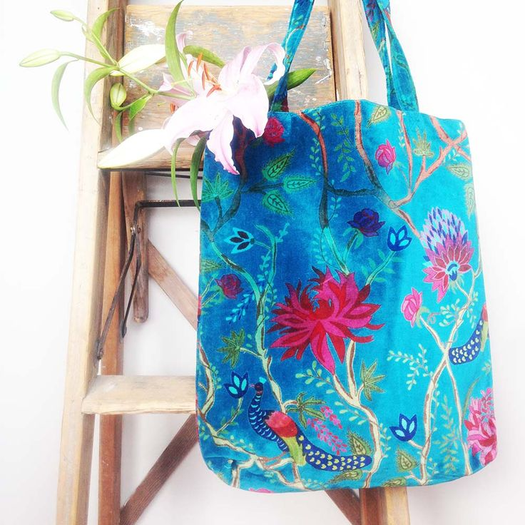 A gorgeous indigo blue velvet tote bag, screen printed with tropical flowers and a peacock in beautiful colours. www.rosaliving.co.nz www.rosaliving.com.au