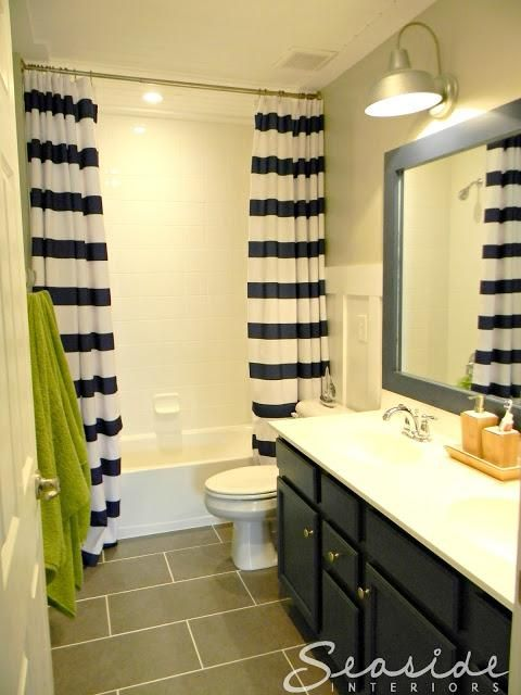 Tiffany Note: Color scheme (navy, lime green)+stripes; Kids Nautical Bathroom wall color: Repose Gray by Sherwin Williams