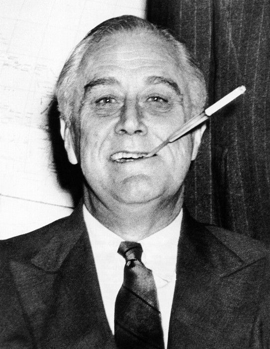 President Franklin Roosevelt in his White House study with his trademark long cigarette holder. 1943. (CSU_ALPHA_17) CSU Archives/Everett Collection