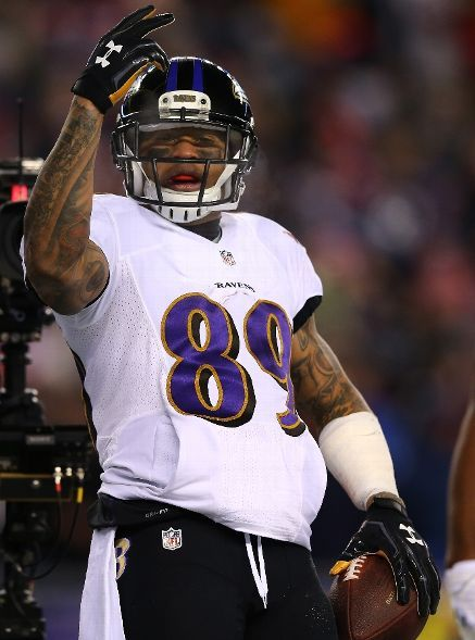 Baltimore Ravens vs. New England Patriots - Steve Smith #89 of the Baltimore Ravens celebrates after scoring a touchdown in the first quarter against the New England Patriots during the 2014 AFC Divisional Playoffs game at Gillette Stadium on January 10, 2015 in Foxboro, Massachusetts. (Photo by Elsa/Getty Images)