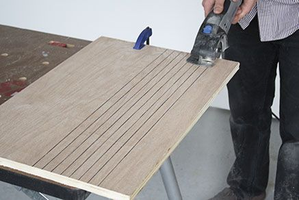 "Step 3:  Before you begin securing the newly cut pieces into place, you'll need to create a series of cleats.     We marked a series of 1"" cleats on extra 3/4"" plywood we had on hand. Using the Saw-Max equipped with the same SM500 Wheel, cut along the marked lines."