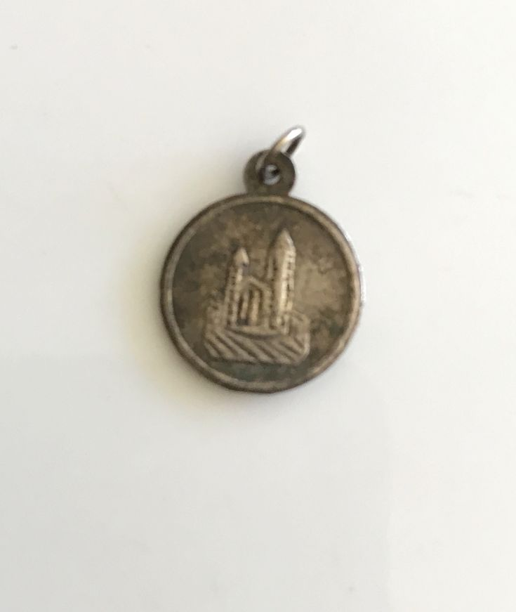 ..........https://www.etsy.com/shop/CoCoBlueTreasures Antique vintage collectibles #bing #googleplus #google #yahoo #pinterest #facebook.............Religious catholic medal St Raphael silver filled pendant vintage 1940's