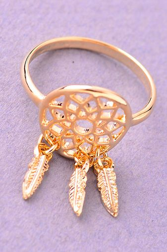 Our bohemian inspired Dreamcatcher Ring is gold plated metal. It features a small dreamcatcher at the center of the ring, with three tiny dangling metal feathers. Fits US standard ring size 6-7. DETAILS: Gold tone plated metal Dreamcatcher design at center Fits US standard ring size 6-7.