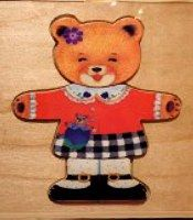 Wooden Paper Bear with clothing; comes in wooden box.  Very nice.