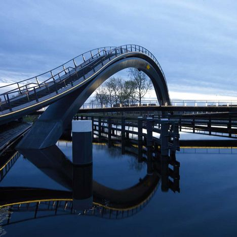 Criss-crossing bridge in Purmerend by NEXT Architects and Rietveld Landscape with an arching upper level and a zig-zagging lower level.