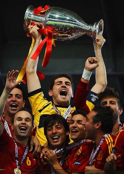 Champions ... Iker Casillas lifts the trophy.   Photo: Getty Images
