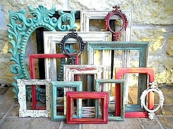 Here's a thought - get antique frames (or cheap wood ones from Hobby Lobby), paint them in your wedding colors (or just cutesy fall colors) and use them in your centerpiece for table