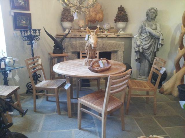 Teak dinning set with round teak table and teak chairs