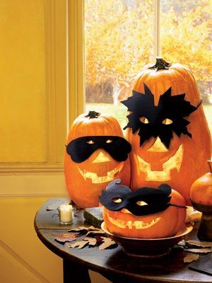 Pumpkins to sit on table at entrance next to the masking tree. Maybe paint the pumpkins black or white and correspond with white or black masks.