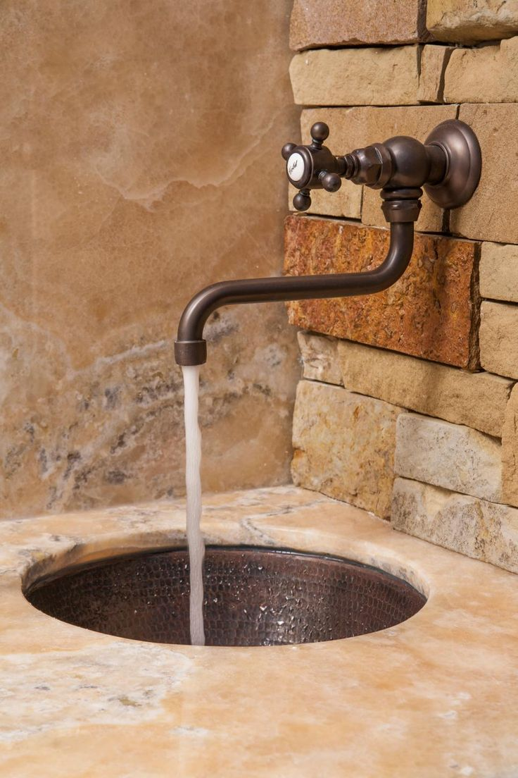 Onyx Countertop And Stone Veneer Walls Beautifully Compliment This Stunning  Wall Faucet By Rohl And Rustic