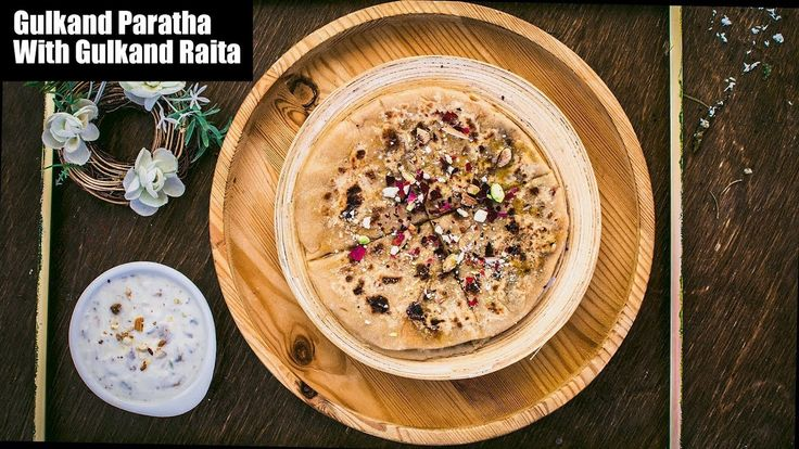 This Gulkand dessert paratha is one of those splendid painless dessert parathas which can only be made with only a few ingredients. This rustic but nutty and pungent gulkand paratha is extremely fuss-free and so full of amazing textures and flavors which are really hard to describe in words. From: www.mygingergarlickitchen.com #Gulkand #Vegetarian #Mithai #paratha #Sweets #Raita #Holirecipe #Videorecipe