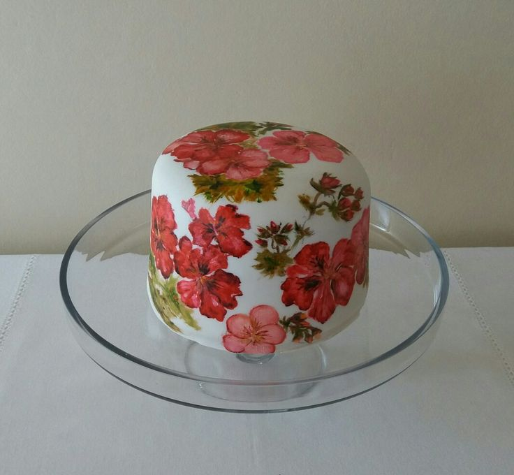 Fruit cake hand-painted with geranium flowers in reds and apricot colours; lovely for the Christmas table!