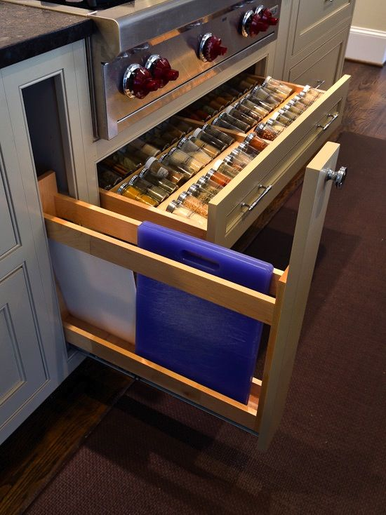 cutting board and spice storage which are obviously paired with wall ovens, which are another dream