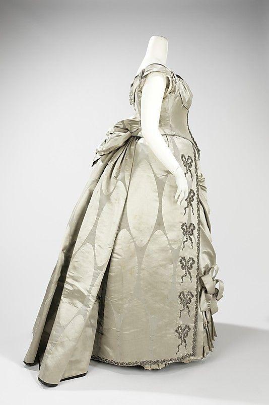 Designer:      Charles Frederick Worth (French (born England), Bourne 1825–1895 Paris)  Date:      1888  Culture:      French  Medium:      silk, metal