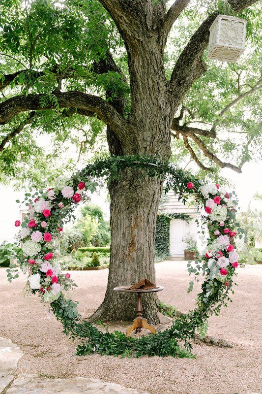 Greenery wreath wedding ceremony backdrop - greenery wreath with white + pink flowers {Pearl Events Austin}