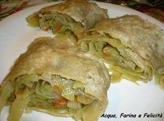 8 foglie di cavolo cappuccio 30 gr di carote mezza cipolla bianca zenzero olio, sale e pepe nero