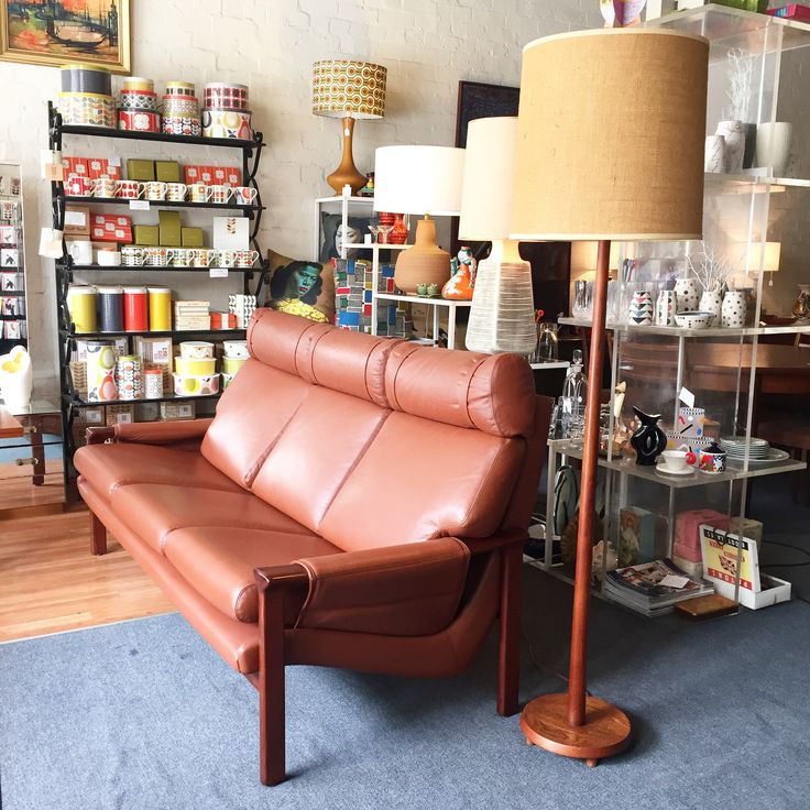 Mid-Century Australian design Tessa T21 couch designed by Fred Lowen 1970's with a teak floor lamp